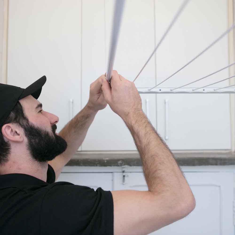 Instalação de varal de teto ou parede
